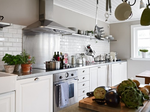 kitchen subway tile backsplash pot rack island